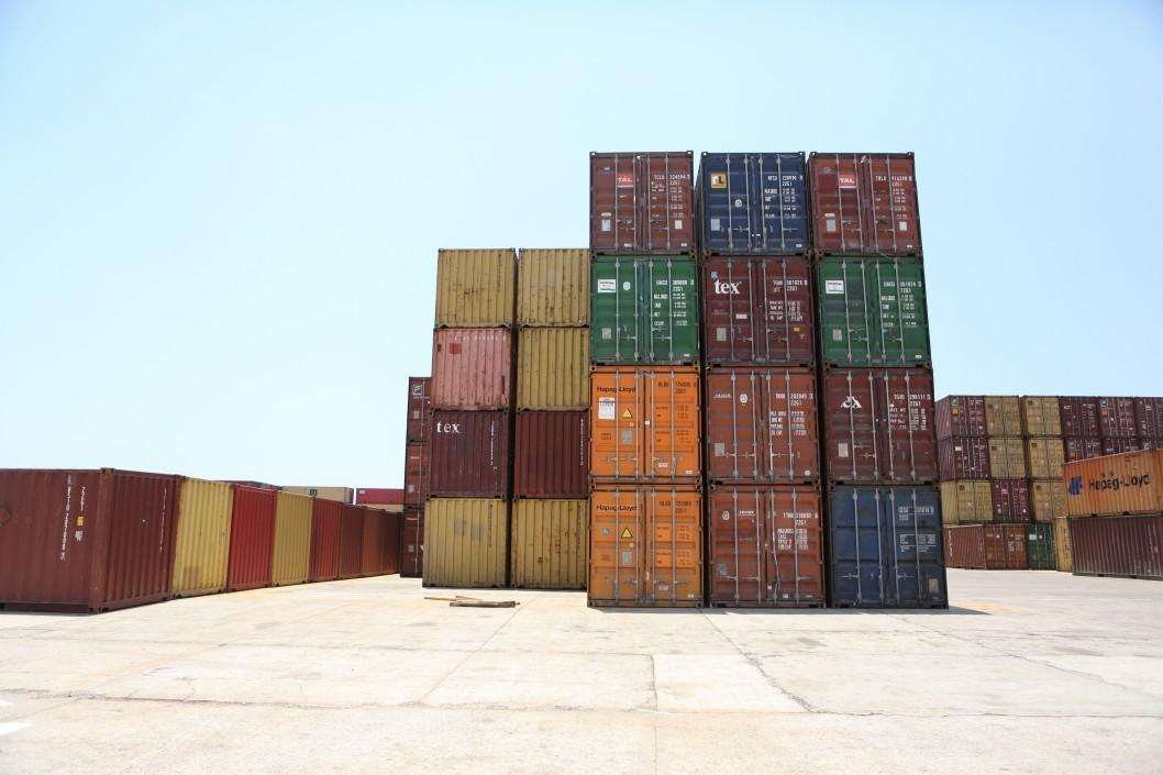 stacked-cargo-containers-at-a-local-port_t20_eo6YWW